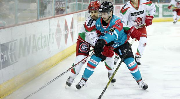 Belfast Giants' Matt Towe with Cardiff Devils Bryce Reddick during Saturday night's Elite League game at the SSE Arena, Belfast. Photo by Darren Kidd/Presseye