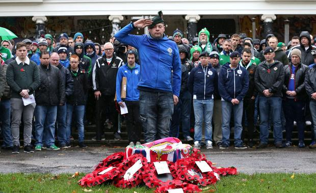 Press Eye - Belfast - Northern Ireland - 12th November 2017 - Photo by William Cherry/Presseye Northern Ireland supporters hold their Act of Remembrance service at Christoph Merian-Park, Basel, ahead of Sundays World Cup Play Off against Switzerland.