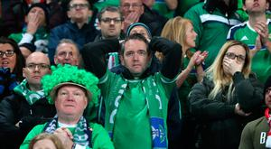 Northern Ireland fans show their dejection as their during the FIFA World Cup Qualifying second leg match at St Jakob Park, Basel. Niall Carson/PA Wire