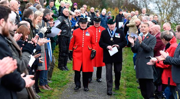 Chelsea Pensioners Walter Swan (front) and Eddie Reid are escorted by Thomas Hill, chair of the Royal British Legion Waterside branch