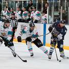 Star wars: Giants players Blair Riley (left) and Brandon Benedict (centre) bid to close down a Dundee Stars attack