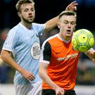 Warrenpoint's Conor McMenamin (left) continued his top form in an unusual role against Carrick.