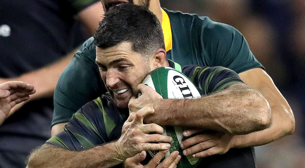 Gripping stuff: Rob Kearney takes on South Africa