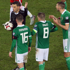 Spot of bother: Oliver Norwood, Steven Davis and Gareth McAuley are baffled by penalty call