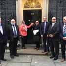 Sinn Féin MPs Francie Molloy and Barry McElduff and the family of Patsy Kelly meet with British Secretary of State, James Brokenshire.