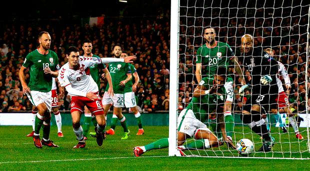 Opener: Denmark's Andreas Christiansen (second left) steers an effort towards goal which goes into the net off Republic of Ireland defender Cyrus Christie