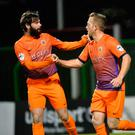 Double delight: Sammy Clingan (right) celebrates after scoring his second penalty last night