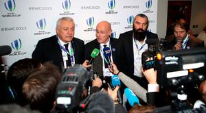 Sebastien Chabal (second right), France 2023 bid president Claude Atcher (left) and France Rugby Federation President Bernard Laporte (centre) speak to the media after France was named as the 2023 Rugby World Cup host.