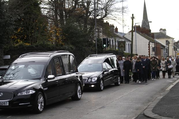 Family and Friends walk behind the coffin's of twin brothers Waldemar and Krzysztop Kropidlowski from St Peter's church in Lurgan. Pic by Peter Morrison