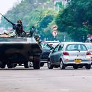 An armoured personnel carrier stations by an intersection as Zimbabwean soldiers regulate traffic in Harare on November 15, 2017. Zimbabwe's military appeared to be in control of the country on November 15 as generals denied staging a coup but used state television to vow to target