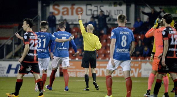 Linfield's Mark Stafford gets a red card that had initially been awarded to David Cushley.