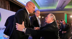 Well done: IRFU President Philip Orr (right) congratulates French Federation President Bernard Laporte
