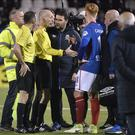 Seeing red: Linfield boss David Healy confronts referee Raymond Hetherington after David Cushley's red card was rescinded
