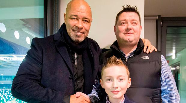 Star attraction: Paul McGrath with Peter Murphy and his son Daniel Murphy, who was celebrating his 11th birthday, at last night's event hosted by the Belfast Telegraph at Windsor Park, 'An Evening with Norman Whiteside and Paul McGrath