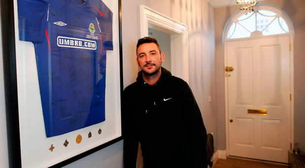 Happy memories: Michael Gault with his framed Linfield shirt