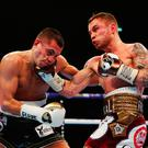 Damaging: Carl Frampton lands a big uppercut on Scott Quigg