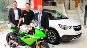 Driving forces: Announcing Vauxhall's sixth year as title sponsor of the International North West 200 are (from left) Simon Oldfield, Vauxhall's marketing director, North West 200 race winner Martin Jessopp and Event Director Mervyn Whyte