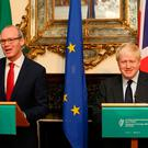 Ireland's Foreign minister Simon Coveney (L) and Britain's Foreign Secretary Boris Johnson take part in a joint press conference at the Irish Foreign affairs office in Dublin on November 17, 2017. / AFP PHOTO / Paul FAITHPAUL FAITH/AFP/Getty Images