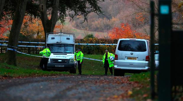 Police at the scene near Waddesdon, in Buckinghamshire, where a mid-air collision between a helicopter and an aircraft has resulted in a