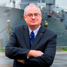 Steve Aiken MLA at the Belfast-moored HMS Caroline, where he was a reservist at just 15 years of age