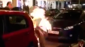 Steven Logan sets his beard on fire in Belfast's High Street