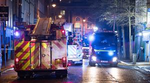 Fire fighters at the scene on Monday in Donegall Street. Pic Kevin Scott.