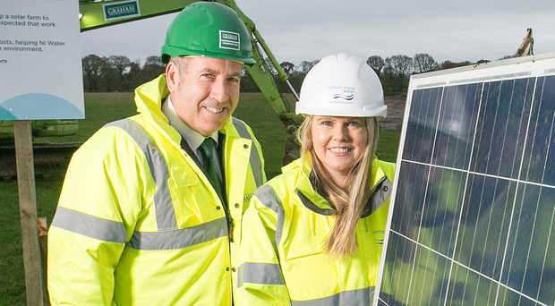 Sara Venning, chief executive of NI Water, and Leo Martin, managing director of Graham Construction Civil, at the launch of NI Water's £7m solar farm