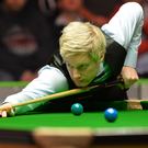 Right on cue: Neil Robertson eyes up a shot during his first round victory at the NI Open