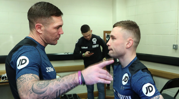 Listen up: Jamie Moore passes on some advice to Carl Frampton ahead of the Jackal's victory