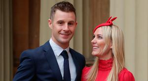 Superbike world champion Jonathan Rea with his wife Tatia, after being presented with an MBE by the Duke of Cambridge, at Buckingham Palace, London. PRESS ASSOCIATION Photo. Picture date: Tuesday November 21, 2017. See PA story ROYAL Investiture. Photo credit should read: Yui Mok/PA Wire