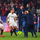 Joy and pain: Guido Pizarro with his Sevilla team-mates after scoring the equaliser