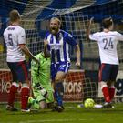 Get in: Gareth McConaghie celebrates scoring the opener for Coleraine last night