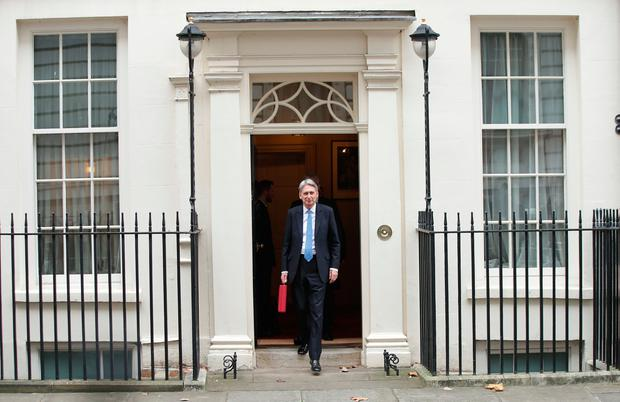 Chancellor Philip Hammond holding his red ministerial box outside 11 Downing Street, London, before heading to the House of Commons to deliver his Budget. PRESS ASSOCIATION Photo. Picture date: Wednesday November 22, 2017. See PA story BUDGET Main. Photo credit should read: Yui Mok/PA Wire