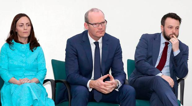 Handout photo issued by the SDLP of (left to right) , SDLP Deputy Leader Nicola Mallon, Simon Coveney TD and SDLP Leader Colm Eastwood, during a Business Breakfast at Crumlin Road Jail, Belfast. Declan Roughan/Press Eye/PA Wire