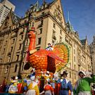 Parade participants guide a turkey float at the annual Macy's Thanksgiving Day Parade in New York City. (Photo by Yana Paskova/Getty Images)