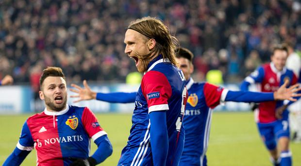 Basel's Michael Lang, center, celebrates with his teammate Basel's Renato Steffen, left, after scoring a goal, during the Champions League Group A soccer match between Switzerland's FC Basel 1893 and England's Manchester United at the St. Jakob-Park stadium in Basel, Switzerland, Wednesday, Nov. 22, 2017. (Patrick Straub/Keystone via AP)