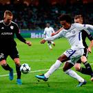 Up close: Chelsea man of the match Willian takes on Qarabag's Jakub Rzezniczak