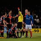 Seeing red: Confusion galore as Crusaders' David Cushley (right) is sent off and then rescued last week