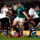 Ireland's Chris Farrell and Fiji's Dominiko Waqaniburotu (right) during last weekend's Autumn International at the Aviva Stadium