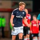 Double delight: Dundee's Mark O'Hara celebrates
