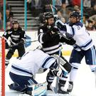 Getting stuck in: Providence Friars man Brandon Duhaime with Jeremy Swayman and Brady Keeper of the Maine Black Bears