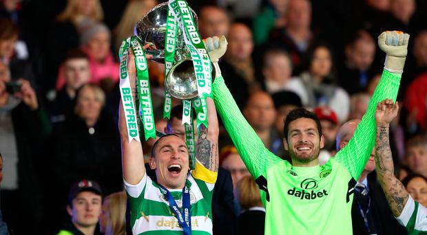 Celtic's Scott Brown lifts the trophy after the Betfred Cup Final at Hampden Park, Glasgow / Credit: Andrew Milligan/PA Wire.