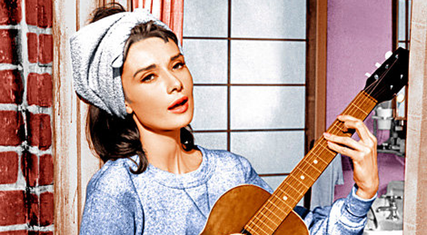 Fine voice: Audrey Hepburn sings Moon River in Breakfast at Tiffany's