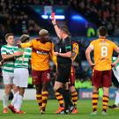 Cedric Kipre of Motherwell gets sent off after conceding a penalty in the Betfred Cup final. Photo by Steve Welsh/Getty Images