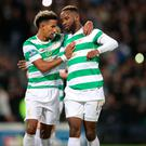 Scott Sinclair celebrates with goal-scorer Moussa Dembele after the successful penalty made it 2-0 in the Betfred Cup final. Photo by Steve Welsh/Getty Images