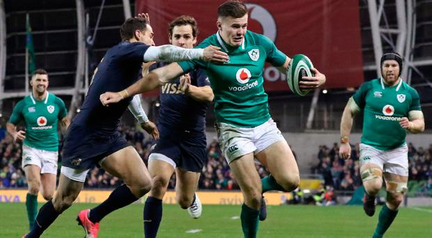 Ireland's wing Jacob Stockdale on his way to scoring against Argentina.