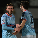 Get in: Conor McCloskey after scoring Ballymena's second
