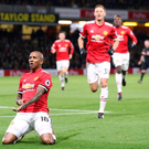 At the double: Ashley Young celebrates his and United's second