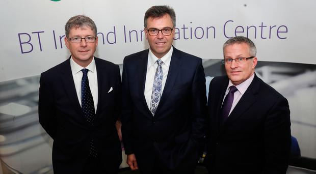 Howard Watson, CEO of BT technology, service and operations, Alastair Hamilton, CEO of Invest NI, and Ulster University vice-c hancellor Professor Paddy Nixon at the launch of the BT Innovation Centre in Belfast