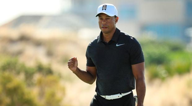 The old routine: Tiger Woods after a birdie in the Bahamas